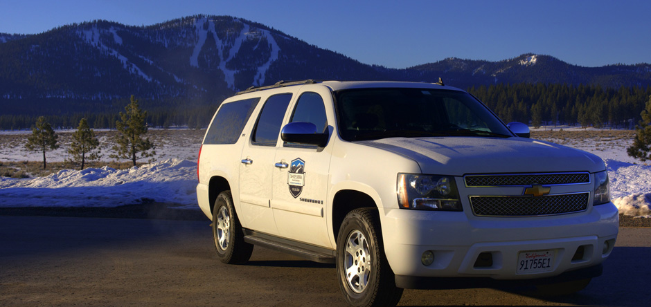 Tahoe Sierra Transportation private car service parked in front of a Lake Tahoe ski resort in California.
